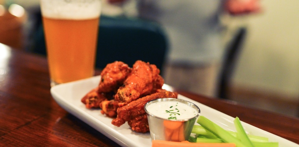 Photo of a beer and chicken wings